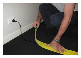 Apply the TripSafe carpet cable holder on your loose electrical cords